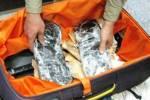 کشف چمدان تریاک از یک مسافر اتوبوس